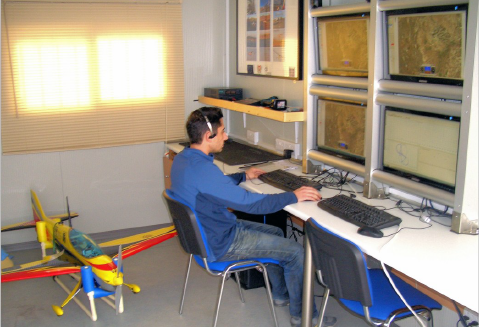 CyI Researcher C. Keleshis at the controls of the APAESO Control and Operation Facility during a mission